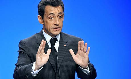 French president Nicolas Sarkozy gestures as he speaks in Neufchateau, eastern France