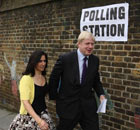 Boris Johnson and his wife Marina arrive at a polling station at Laycock Primary School, Islington