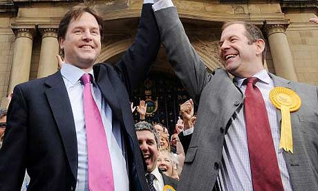 Nick Clegg, left, celebrates the Lib Dems' local elections performance in Sheffield