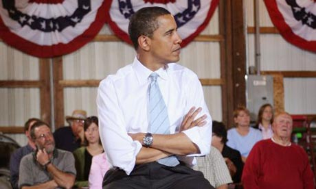 Barack Obama waits to be introduced at a meeting in South Bend, Indiana