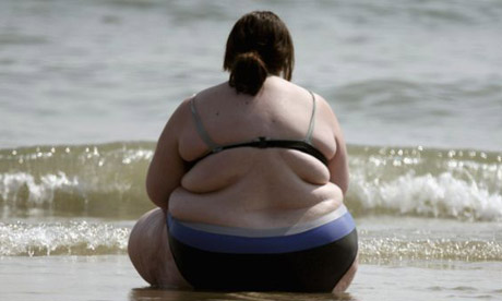 Obese woman on beach