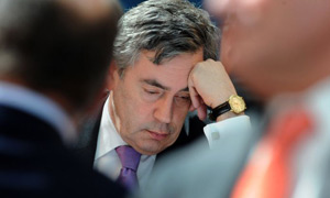 Gordon Brown listens to delegates at a United Nations development conference at Canary Wharf, London