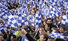 Chelsea fans wave their flags in the stands