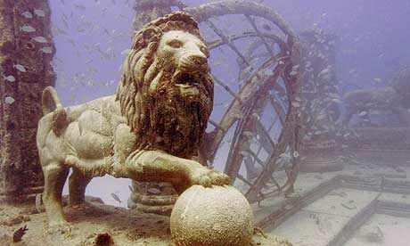 Fish swim near a sculpture in the Neptune memorial reef off the coast of Key Biscayne, Florida