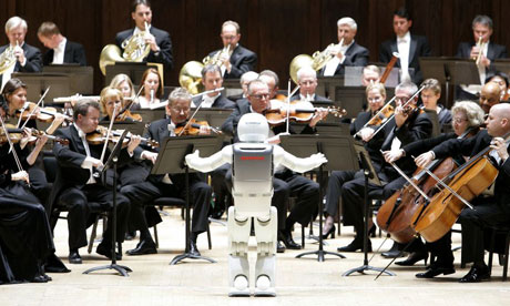 Honda's Asimo robot conducts the Detroit Symphony Orchestra.