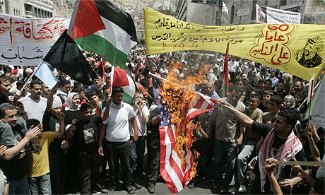 Palestinians set a US flag on fire during a Nakba rally in the West Bank city of Nablus