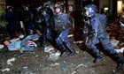 Riot police clash with Rangers fans in Piccadilly Gardens in Manchester after last night's defeat