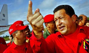 Hugo Chavez, president of Venezuela, talks to the press as he arrives at the Santa Clara airport, Cuba