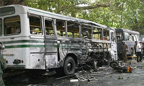 The wreckage of a police bus targeted by a suicide attack in Colombo