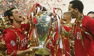 Manchester United's Cristiano Ronaldo and Rio Ferdinand celebrate with the trophy