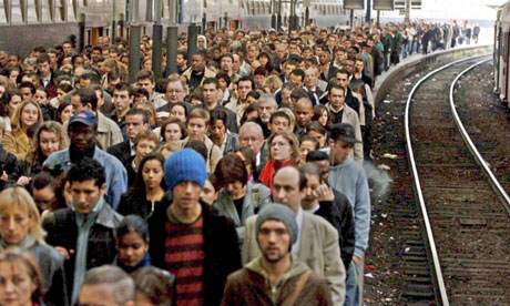 Commuters crowd the platform at Gare Saint Lazare in Paris during a strike