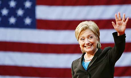 Hillary Clinton waves to the crowd at the National Building Museum in Washington