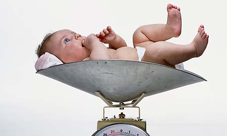 A baby on a weighing scale