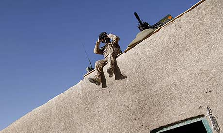 Corporal Lachlan MacNeil at a British observation post on the edge of Garmsir, Afghanistan