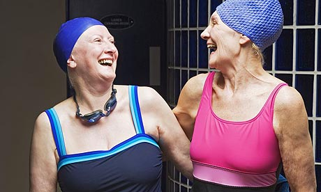 Two women in swimming costumes