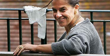 The artist Tracey Emin poses next to her latest work overlooking Folkestone Harbour