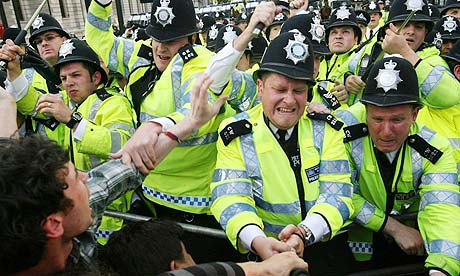 Clashes take place between police and anti-war protesters in Parliament Square, London
