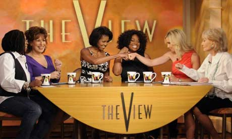 Michelle Obama bumps fists with guests on the US TV chatshow The View