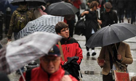 Crowds of shoppers walk with umbrellas in the rain in Covent Garden, London. Photo: Linda Nylind