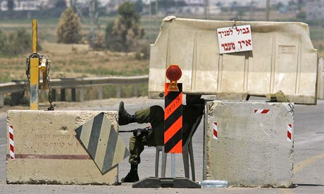 An Israeli soldier relaxes at the Karni crossing with the Gaza Strip