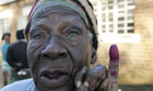 Zimbabwe voter with dyed finger