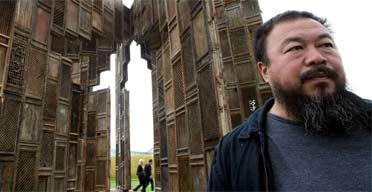 Chinese artist Ai Weiwei poses in front of his installation