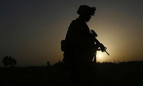 A US marine with the 24th Marine Expeditionary Unit patrols in the town of Garmser, in Helmand province, Afghanistan