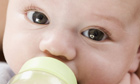 Close up of baby drinking from a bottle