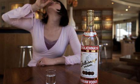 Woman drinking Vodka. Photograph: Martin Godwin