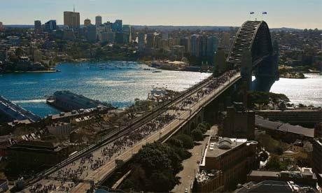Pilgrims walk across the Sydney Harbour Bridge, July 2008