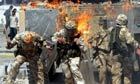 British troops covered in flames from a petrol bomb thrown in Basra
