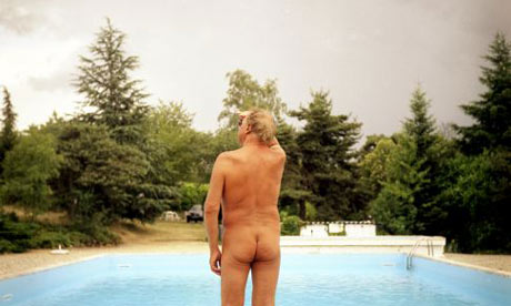 A nudist by a swiming pool in France. Photograph: Fred Dufour/AFP