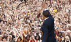 Barack Obama waves to the crowd in Berlin. Photograph: Carsten Koall/Getty Images