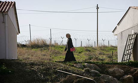 An Israeli Jewish settler walks in the community of Maskiot in the Jordan Valley near the West Bank town of Nablus