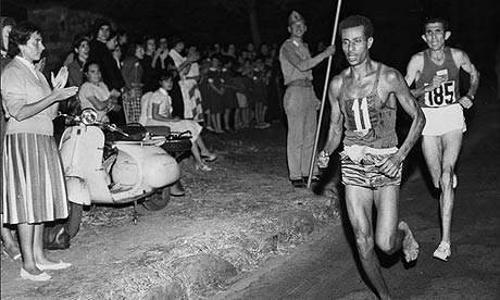 Abebe Bikila of Ethiopia, running barefoot, draws away from Abdesselem Rhadi of Morocco near the finish of the marathon at the 1960 Rome Olympics. He went on to win with a new Olympic record time of 2 hours 15 minutes 16 seconds