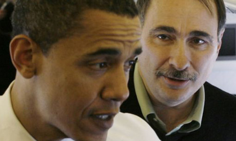 David Axelrod, right, listens as Barack Obama speaks to the media