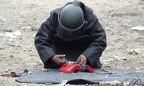 A bomb squad officer defuses a live device in Ahmedabad, India. At least 45 people were killed in a series of up to 16 explosions across the city