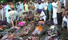 Police and villagers surround the dead bodies of devotees at the civil hospital in Anandpur Sahib, in northern India