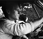 Robert Kennedy drives his car in Virginia with his dog Freckles
