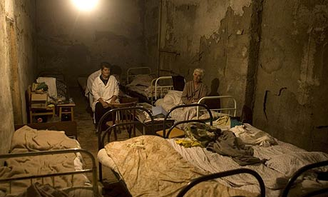 Ossetians stay in a basement of a destroyed hospital in Tskhinvali