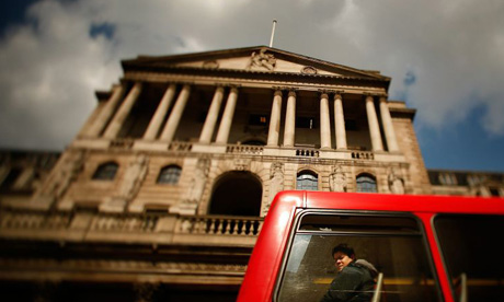 A bus passes by the Bank of England