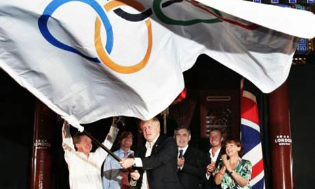 Boris Johnson waves the Olympic flag
