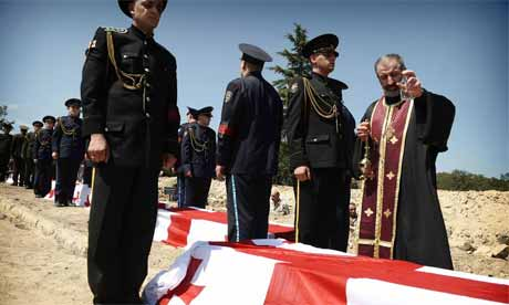 A patriarch blesses coffins of unknown Georgian soldiers in Mukhadgverdi, west of Tbilisi; on August 28, 2008