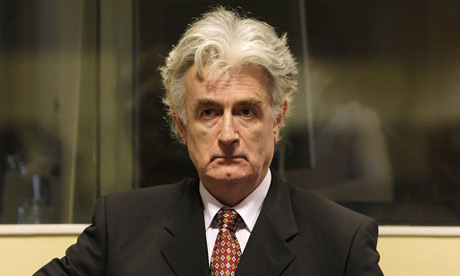 Former Bosnian Serb leader Radovan Karadzic attends a hearing at the UN war crimes tribunal in The Hague August 29