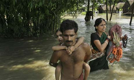A family wades through flood waters to catch a relief boat, northeast of Patna, India, Aug. 31, 2008