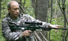 Russian prime minister Vladimir Putin holds a tranquiliser gun whilst on a research day to save the Amur tiger