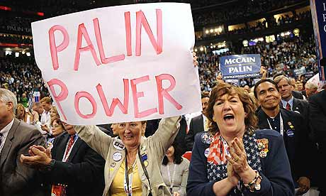 Delegates cheer as Sarah Palin takes the stage at the Republican National Convention in St Paul.