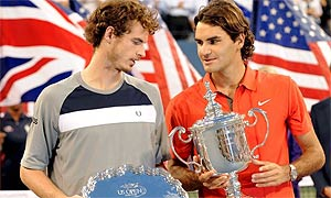 Roger Federer (r) holds the US Open championship trophy after defeating Andy Murray