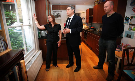 Gordon Brown looks at energy-saving measures in the London home of the Sheehan family