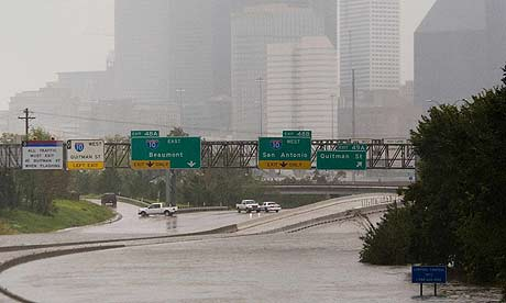 Floodwater covers a highway north of downtown Houston